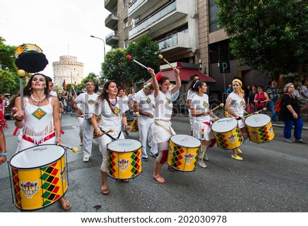 THESSALONIKI, GREECE- JUNE 21, 2014: Participants of the Gay Pride playing drums during the parade. Members of the LGBT protested for their right to be diverse in Thessaloniki, Greece.  - stock photo