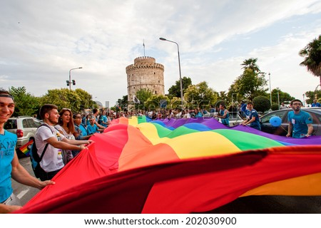 THESSALONIKI, GREECE- JUNE 21, 2014: Participants with the rainbow flag, the symbol of the gay rights movement, during the annual Gay Pride parade event in Thessaloniki, Greece. - stock photo