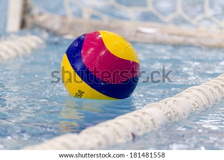 THESSALONIKI, GREECE MAR 5, 2014 : A water polo ball floating on the water in a pool during the water polo game PAOK vs Nereas on March 5, 2014.
