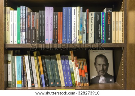 Thessaloniki, Greece- March 16, 2015: Bookshelves in a bookstore in Thessaloniki, Greece - stock photo