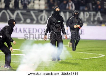 THESSALONIKI, GREECE - MARCH 02, 2016: PAOK fans clash with riot police during the semifinal Greek Cup game between PAOK and Olympiacos played at Toumba stadium - stock photo