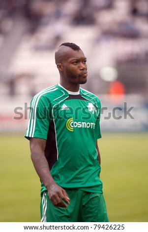 THESSALONIKI, GREECE -MAY 8: International France football player Djibril Cisse warming up for the match against Paok fc in Toumba stadium on May 8, 2011 in Thessaloniki,Greece