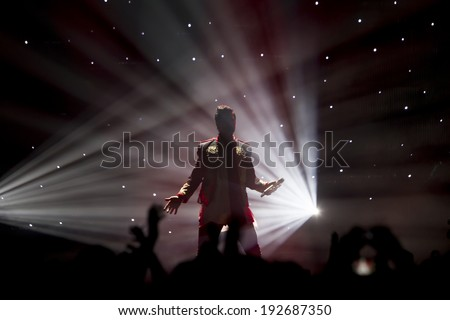 THESSALONIKI, GREECE, MAY 8 2014: Singer Sakis Rouvas performing live on stage for the Ace of Heart tour at Sports arena in Thessaloniki. - stock photo
