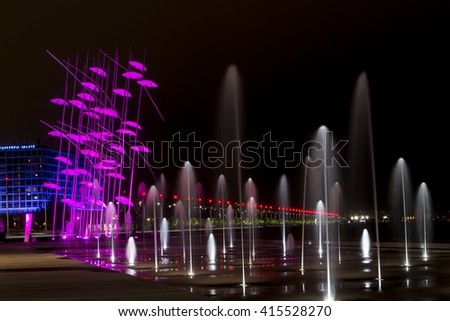 Thessaloniki, Greece, Oct 21, 2015: Umbrellas of Thessaloniki, Greece. The sculpture was illuminated with the color that symbolizes breast cancer to raise awareness about the disease.