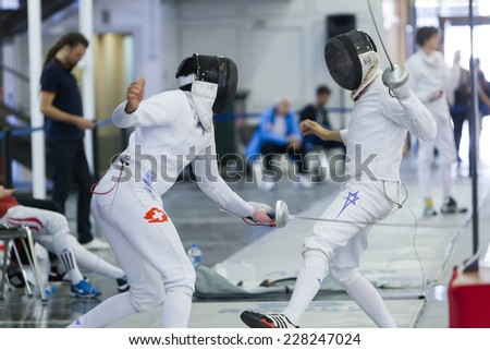 THESSALONIKI, GREECE - OCT 19, 2014 : Young athletes competing during the World Youth Fencing Championships 2014. Over 150 fencers from 25 countries took part at the championships.