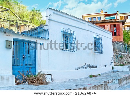 THESSALONIKI, GREECE - OCTOBER 17, 2013: The old residential houses in modern city can be found on the hills next to the rampart, on October 17 in Thessaloniki.