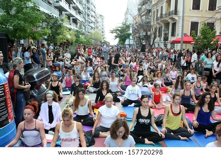 THESSALONIKI, GREECE - SEPT 22 : People perform yoga training during the Day without Car outdoor activities on September 22, 2013 Thessaloniki, Greece.