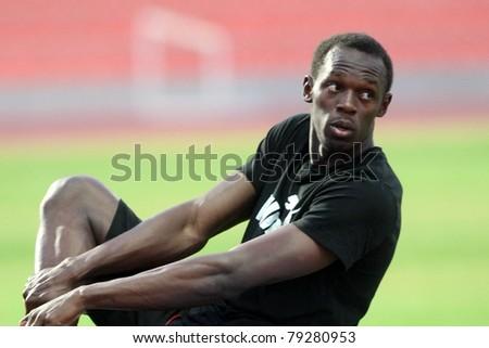 THESSALONIKI, GREECE -SEPTEMBER 11:Jamaican U. Bolt streching in the training center for the IAAF World Athletics Finals main event in Kaftatzoglio Stadium on September 11, 2009 in Thessaloniki,Greece - stock photo