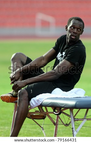 THESSALONIKI,GREECE -SEPTEMBER 11:Jamaican U. Bolt stretching in the training center for the IAAF World Athletics Finals main event in Kaftatzoglio Stadium on September 11, 2009 in Thessaloniki,Greece - stock photo