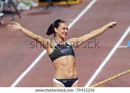 THESSALONIKI, GREECE -SEPTEMBER 12: Yelena Isinbayeva after a successful jump for the IAAF World Athletics Finals main event in Kaftatzoglio Stadium on September 12, 2009 in Thessaloniki,Greece
