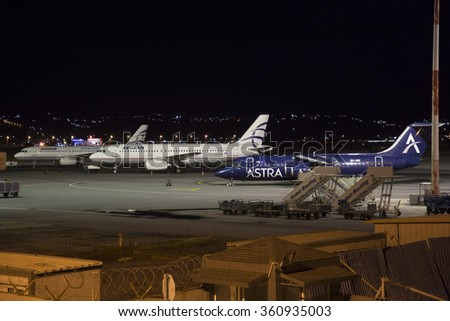"Thessaloniki "" Makedonia "" International Airport, Greece -  8 January 2016. The apron of the airport during the night with Aegean Airlines Airbus and Astra Airlines BAe Avro"