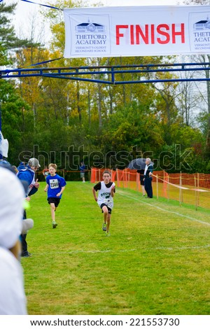 THETFORD CENTER, VT, USA - OCTOBER 4, 2014: Middle school boys running the 24th annual Thetford Academy Woods Trail Run, middle school boys division, finish line.