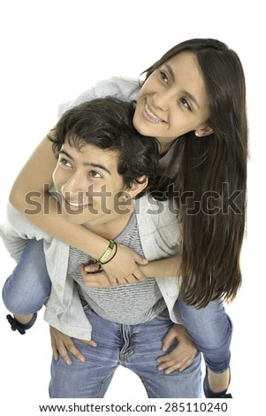 They are a happy couple, he is raising she and smile.