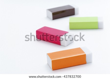They lined up in random eraser - stock photo