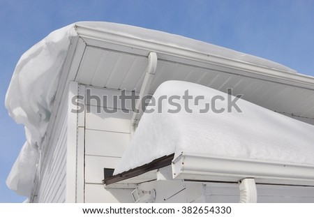 Thick and lot of snow at the roof - stock photo