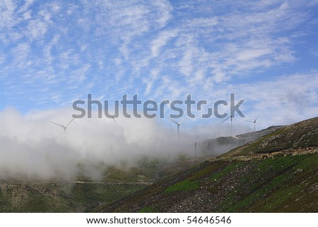 thick clouds hanging over the mountains - stock photo