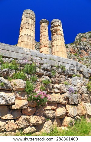 Thick columns of the Apollo's temple against the blue sky, Delphi, Greece - stock photo