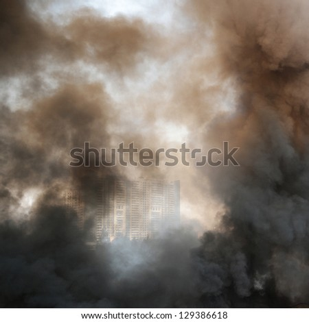thick dark smoke in a fire. - stock photo