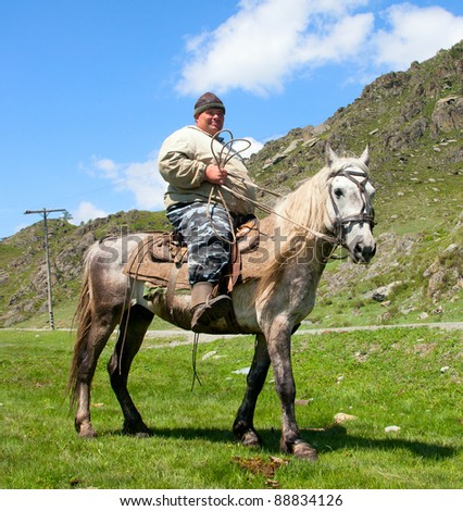 Thick dirty man on horseback. What looks like the Sancho Panza