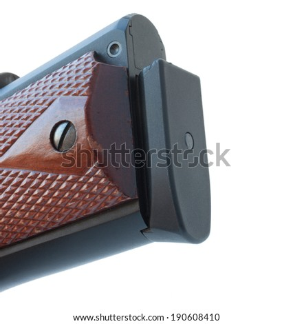 Thick pad on the bottom of a handgun magazine to hold cartridges - stock photo