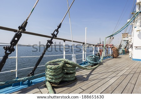Thick ropes on a wooden sailing ship floor - stock photo