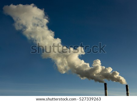 Thick smoke from factory chimneys. Pipe with smoke. Heat energy network. Harmful emissions into the atmosphere. Air pollution and disruption of the Earth's ozone layer. Water pollution and nature. 3