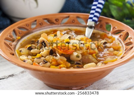 thick soup with beans and celery, carrots, bell pepper, onion - stock photo