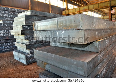thick steel sheets in a warehouse - stock photo