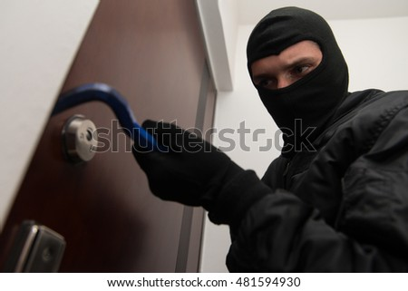 Thief Burglar Force Lock Metal Door With A Tool During House Breaking