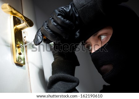 Thief Burglar opening  door - stock photo