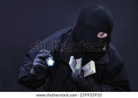 Thief commits a crime sensed danger - stock photo