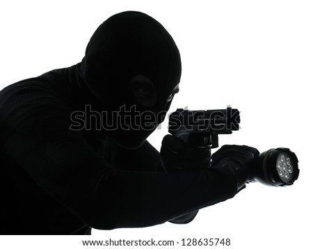 thief criminal terrorist in silhouette studio isolated on white background - stock photo