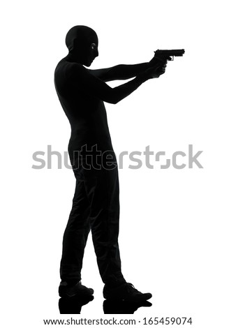thief criminal terrorist man aiming gun in silhouette studio isolated on white background - stock photo