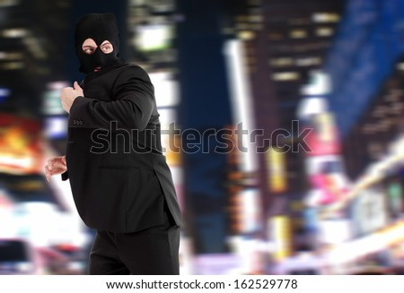 Thief escaping in the night - stock photo
