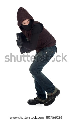 thief getting away - criminal in balaclava with the laptop - stock photo