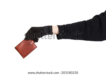 Thief holding a brown leather purse isolated on white background - stock photo