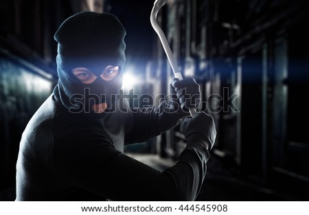 Thief holding a crowbar - stock photo