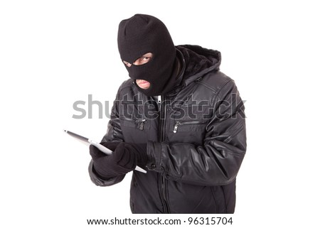 Thief holding a laptop, isolated over white background - stock photo