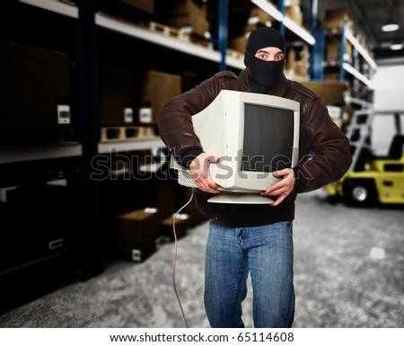 thief in action classic warehouse and forklift - stock photo
