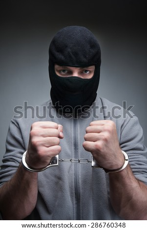 Thief in black mask - stock photo