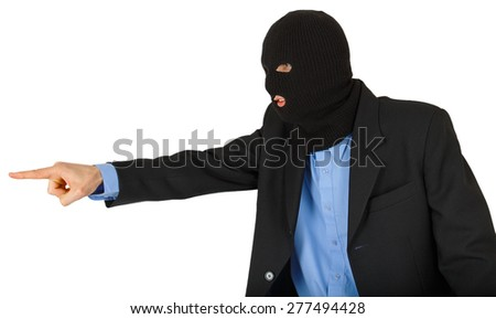 Thief in black mask in suit pointing with his finger isolated on white background