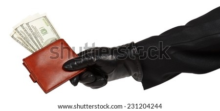 Thief in black suit holding a brown leather purse with dollars isolated on white background - stock photo