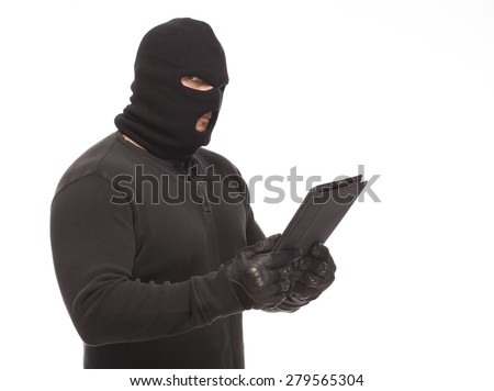 Thief or man in a ski mask and digital tablet on a white background. - stock photo
