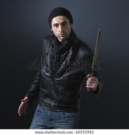 Thief's  threat. Dark background. Square format. - stock photo