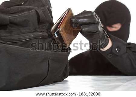 Thief stealing a wallet and a bag on a white background - stock photo