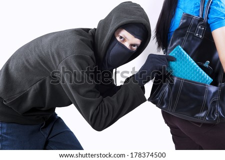 Thief stealing from handbag of a woman - stock photo