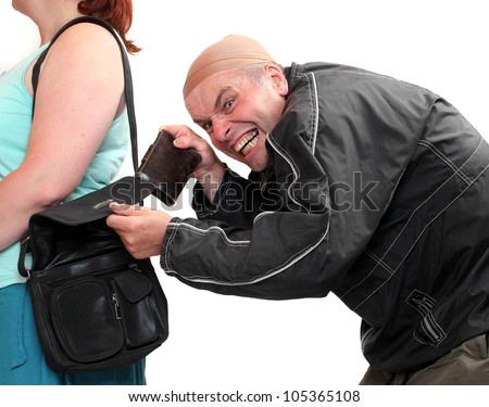 Thief stealing from handbag of a woman. Insurance concept. - stock photo