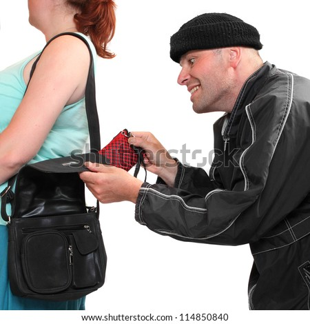 Thief stealing from handbag of a woman. Shopping theme. Insurance concept. - stock photo