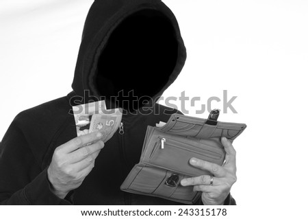 Thief steals a wallet full of personal information and money - stock photo