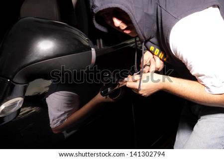 Thief steals car - stock photo